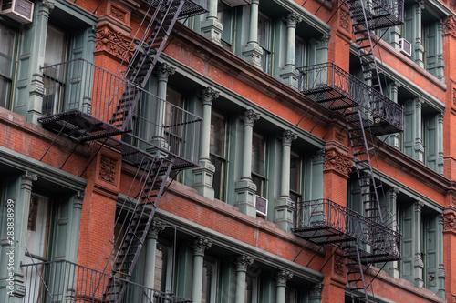 Obraz na płótnie A fire escape of an apartment building in New York city.