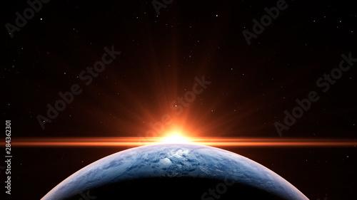 Fotografia, Obraz Sunrise over the planet Earth concept with a bright sun and flare and city light
