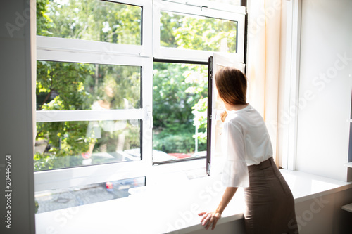 Slika na platnu Businesswoman Looking Out Of A Window