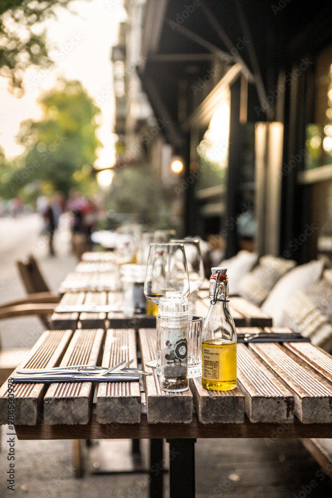 Cafe outdoor table setting with glasses and condiments