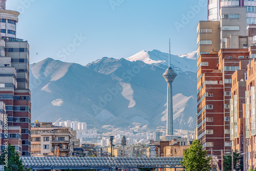 06/05/2019 Tehran,Iran,Famous view of Tehran,Flow of traffic inside, above and nearby round Tohid Tunnel with Milad Tower and Alborz Mountains in Background
