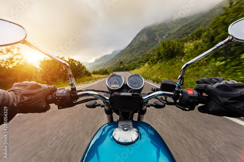 Motorcycle driver riding in mountains