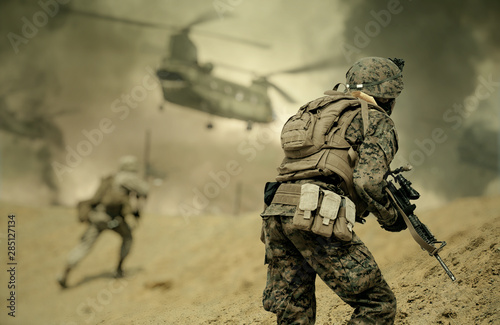 Fotografia Military forces and helicopters between fire and bombs in battle field