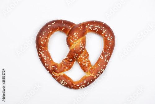 Fototapeta The hand-made pretzel for Octoberfest party on white background