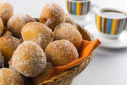 Obraz na płótnie Traditional Brazilian mini fried cakes called bolinho de chuva in a basket in wh