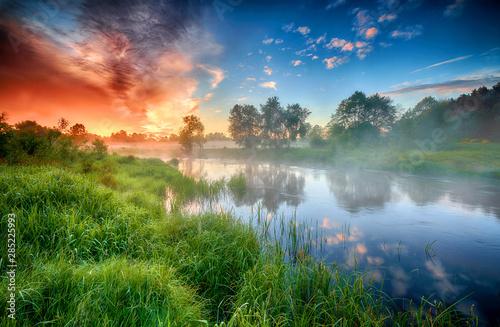 Canvas Print Beautiful summer sunrise over river banks