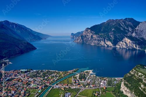 Fototapeta Panorama of Lake Garda surrounded by mountains in Riva del Garda, Italy