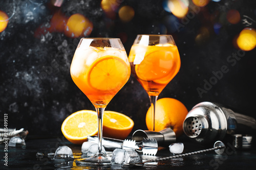 Canvas Print Aperol spritz cocktail in big wine glass with orange and ice, summer alcoholic c
