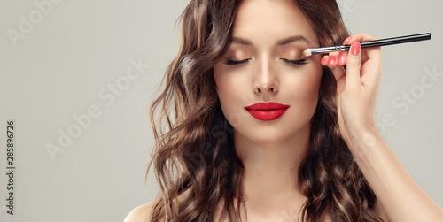 Valokuvatapetti Makeup artist applies  eye shadow