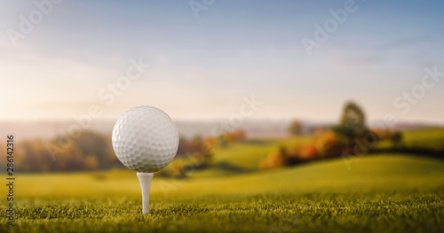Tablou Canvas Close up of a golf ball at the golf course tee with copy space