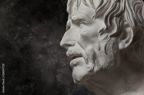 Gypsum copy of ancient statue Seneca head on dark textured background Fototapeta