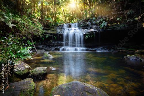 Obraz na plátně Bushland waterfall and oasis