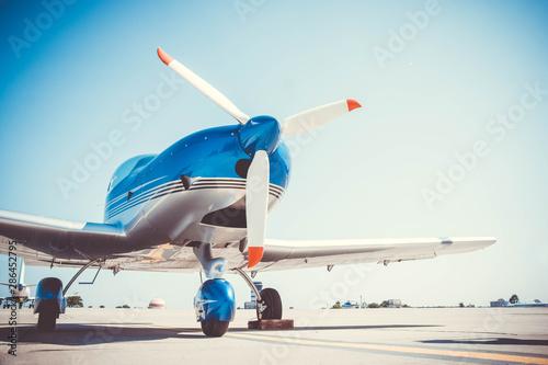 Canvas Print Beautiful shiny sport plane standing on airport runway