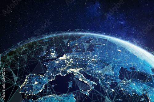 Telecommunication network above Europe viewed from space with connected system for European 5g LTE mobile web, global WiFi connection, Internet of Things (IoT) technology or blockchain fintech