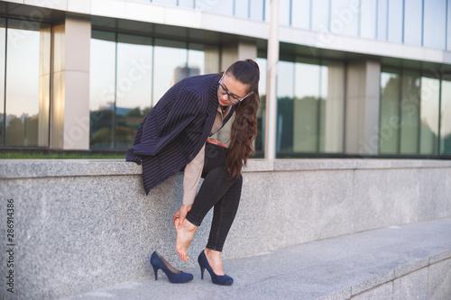 Fotografia, Obraz Woman massaging heel suffering from walking on high heels.