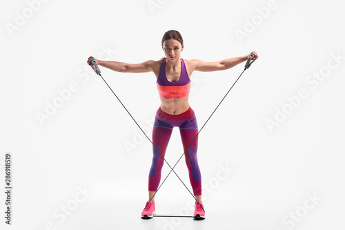Stampa su Tela Powerful woman exercising with resistance rope