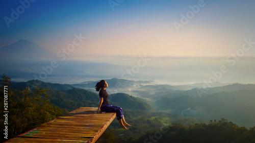 Cuadros en Lienzo Young woman enjoying misty morning at Ngisis hill