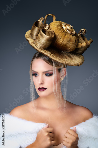 Fotografiet Portrait of a young blonde woman wearing a avant garde hairstyle