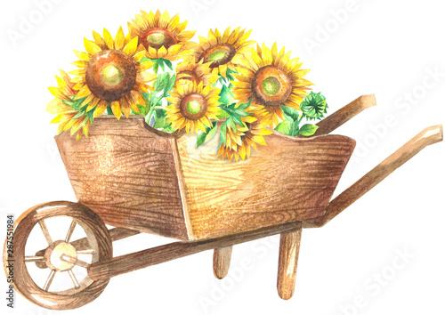Photo Wooden wheelbarrow with sunflowers