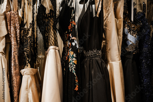 Valokuva Luxurious evening night out sparkling dresses hanging on the rack