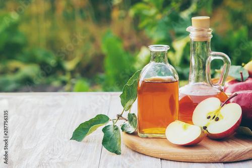 Tablou Canvas Apple cider vinegar in a bottle. Selective focus.