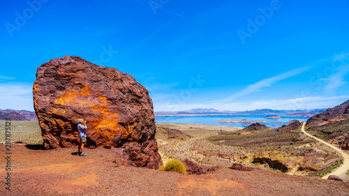 Canvas Print A woman taking a picture of Lake Mead from the Historic Railroad Hiking Trail ne