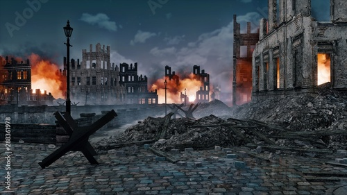 Obraz na płótnie Ruined after the bombing of the World War 2 european city with burning building ruins and street barricade on foreground at night