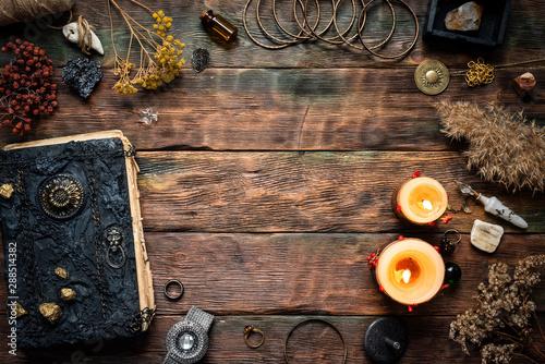 Fototapeta Magic recipe book and a magic potions on a table