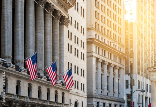 American flags flying in front of the historic buildings of Wall Street in the f Tapéta, Fotótapéta