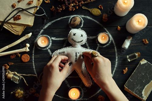 Valokuva In Voodoo doll are needles pricked