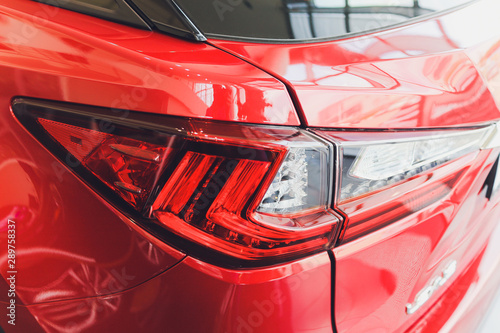 Canvas Print Detail on the rear light of a red car.