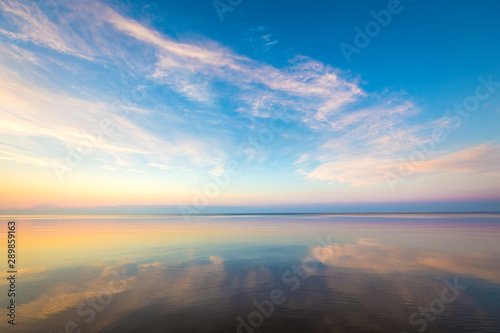 Obraz na plátne Seascape with colorful evening sky