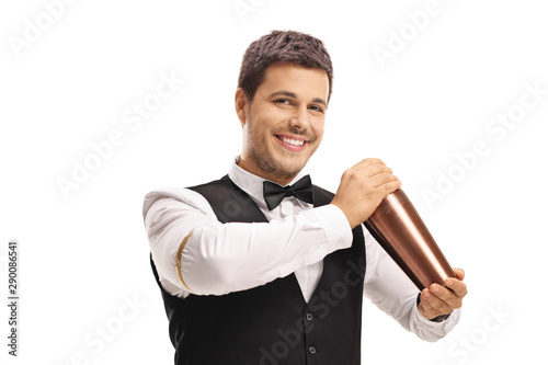 Barman making a cocktail with a shaker
