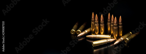 Canvastavla Bullet isolated on black background with reflexion