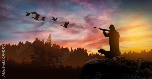 Fotografia, Obraz hunter with dog at sunset