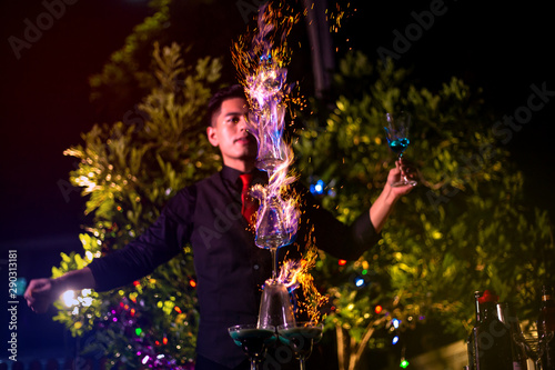 Платно Professional bartender is making flaming lamborghini cocktail at night party