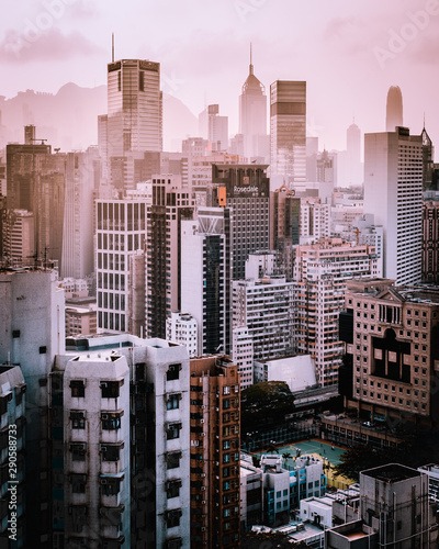 Grey and brown city building under grey smog
