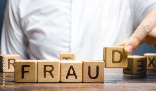 Foto Wooden blocks with the word Fraud and man