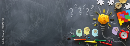 Education concept image. Creative idea and innovation. Crumpled paper as light bulb metaphor over blackboard