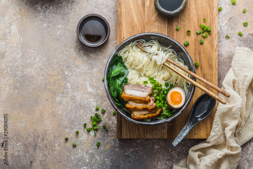Canvas Print Delicious ramen soup with pork, egg and bok choy, copy space
