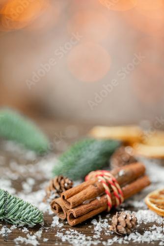 Valokuvatapetti Cinnamon and christmas decoration on wooden table