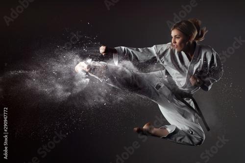 Wallpaper Mural Karate girl bounces and makes a kick