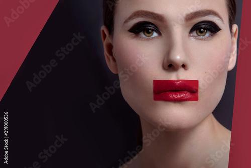Obraz na płótnie High fashion, beauty portrait of young woman model with avant garde fashion art makeup