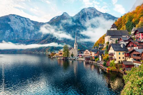 Stampa su Tela Misty autumn scene of Hallstatt lake
