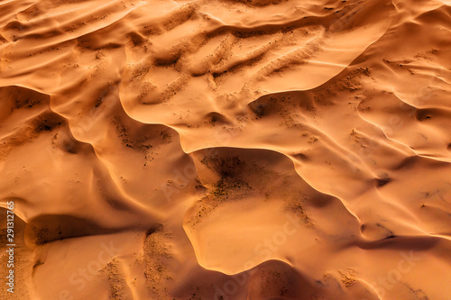 Aerial top view on sand dunes in desert