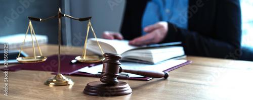 Obraz na płótnie lawyer judge reading documents at desk in courtroom