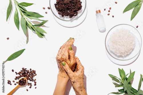 Obraz na plátně Top view female's hands using natural homemade coffee scrub