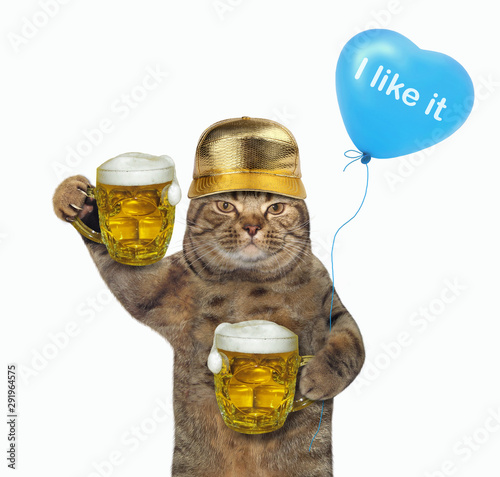 The cat in a golden cap with a blue balloon is holding two mugs of beer Poster Mural XXL