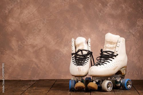 Leinwand Poster artistic roller skates on a wood background