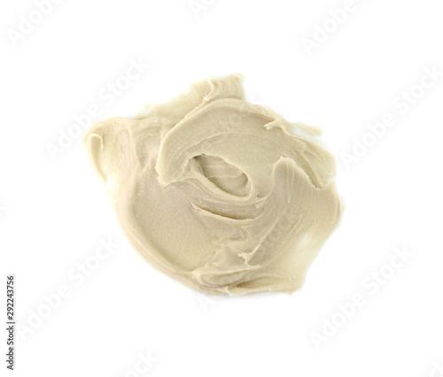 Photo Tahini sauce (sesame seed paste) isolated on white background